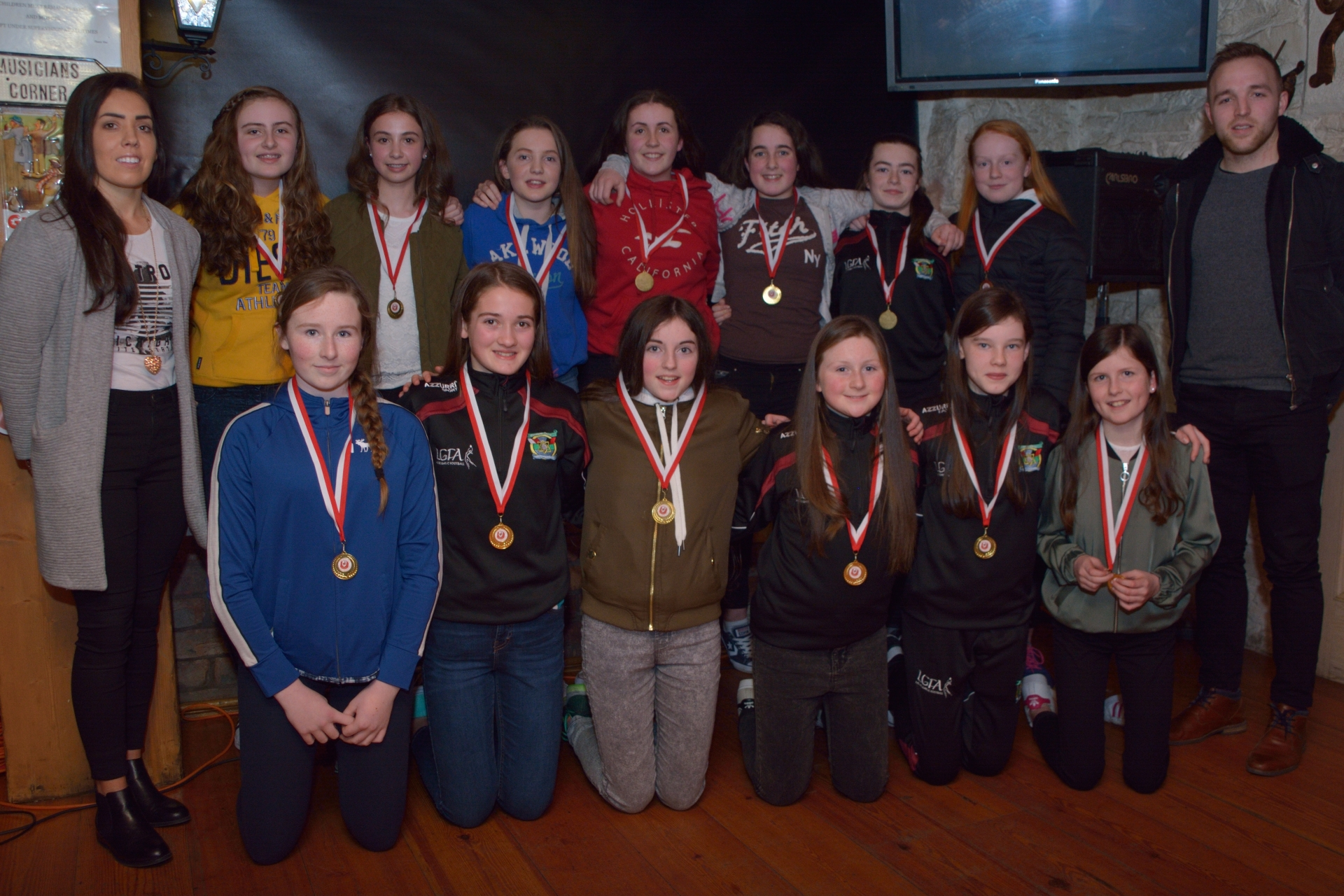 East Kerry Shield Champions, Cromane Under 14 Girls, being presented with their madals by Kerry Senior Players Sarah Houlihan & Darran O'Sullivan